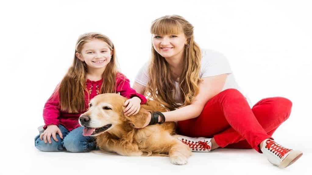 golden retrievers with girls